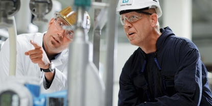 Customer with Endress+Hauser engineer in a plant.